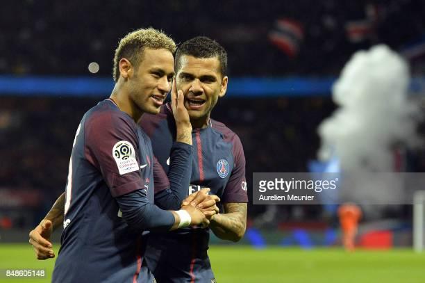 Neymar Jr and Dani Alves of Paris SaintGermain react after Kylian Mbappe scored during the Ligue 1 match between Paris Saint Germain and Olympique...