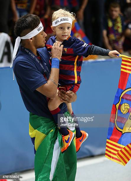 Neymar Jr and his son David Lucca da Silva Santos celebrate the victory after the UEFA Champions League Final between Juventus Turin and FC Barcelona...