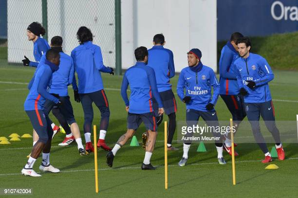 Neymar Jr and Javier Pastore warm up during a training session of Paris Saint Germain PSG at Camp des Loges on January 26 2018 in Paris France