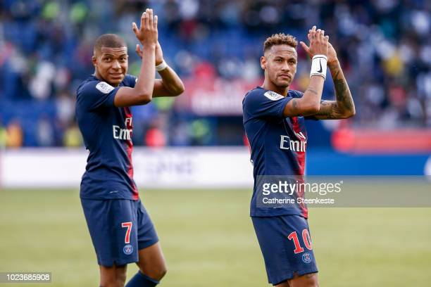 Neymar Jr and Kylian Mbappe of Paris SaintGermain cheer the fans for their support after the Ligue 1 Conforama game between Paris SaintGermain and...