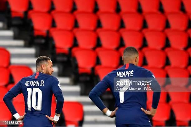 Neymar Jr and Kylian Mbappe of Paris SaintGermain look on during the UEFA Champions League round of 16 second leg match between Paris SaintGermain...