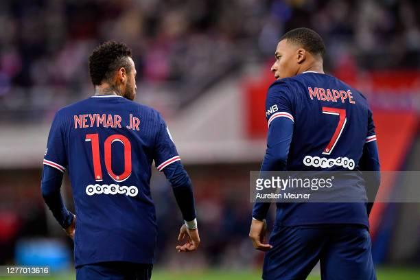Neymar Jr and Kylian Mbappe of Paris Saint-Germain react during the Ligue 1 match between Stade Reims and Paris Saint-Germain at Stade Auguste...