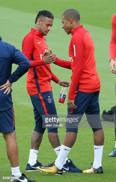 Neymar Jr and Kylian Mbappe of PSG greet each other during Paris Saint Germain training session at Centre Ooredoo training camp on September 6 2017...