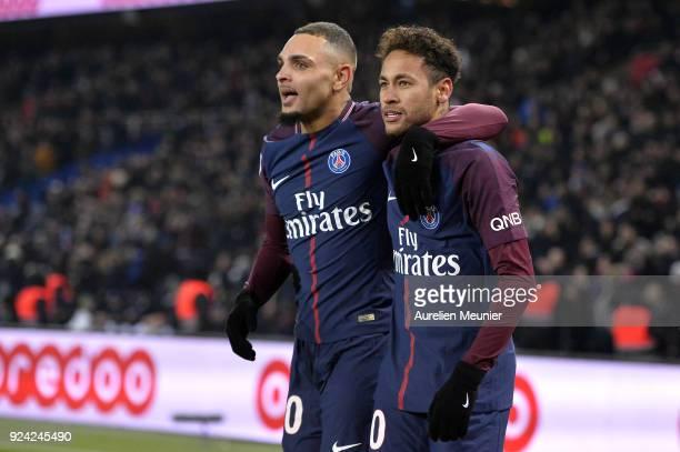 Neymar Jr and Layvin Kurzawa of Paris SaintGermain react after Edinson Cavani scored during the Ligue 1 match between Paris Saint Germain and...