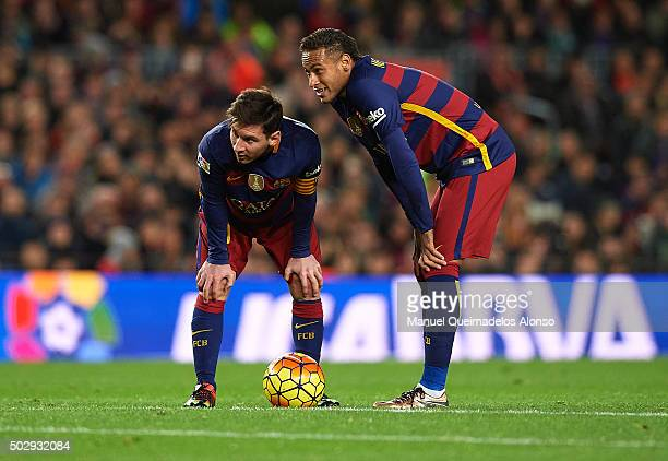 Neymar JR and Lionel Messi of Barcelona look on during the La Liga match between FC Barcelona and Real Betis Balompie at Camp Nou on December 30 2015...