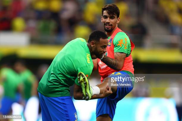 Neymar Jr. And Lucas Paquetá of Brazil warm up prior to a match between Brazil and Uruguay as part of South American Qualifiers for Qatar 2022 at...