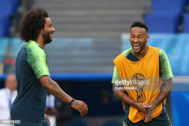 Neymar Jr and Marcelo smile during a Brazil training session ahead of the Round 16 match against Mexico at Samara Arena on July 1 2018 in Samara...