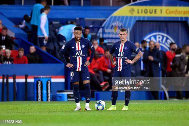 Neymar Jr and Marco Verratti of Paris SaintGermain look on during the Ligue 1 match between Paris SaintGermain and Angers SCO at Parc des Princes on...