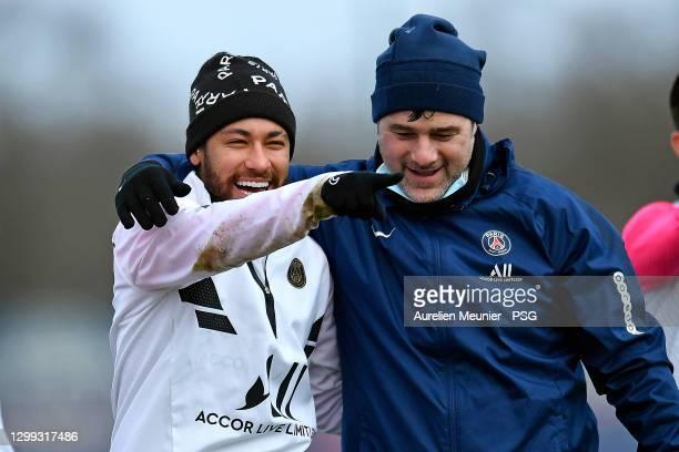 Neymar Jr and Mauricio Pochettino react during a Paris Saint-Germain training session at Ooredoo center on January 29, 2021 in Paris, France.