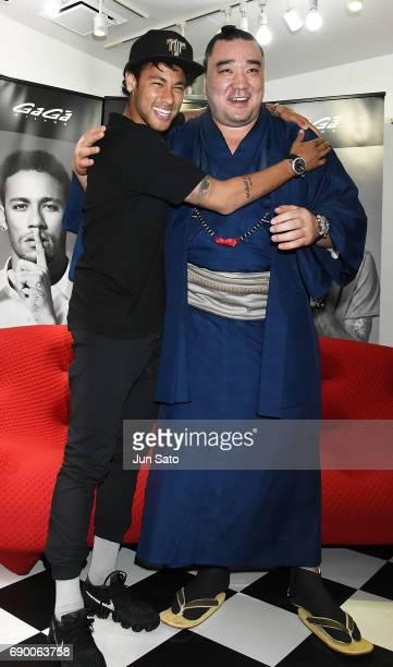 Neymar Jr and Mongolian yokozuna Harumafuji attend the Neymar Jr x Gaga Milano Watch Collection Press Event at Gaga Milano Harajuku store on May 30...