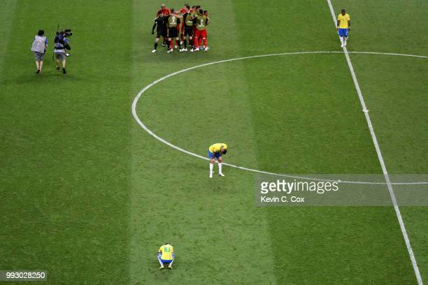 Neymar Jr and Renato Augusto of Brazil look dejected while Belgium players celebrate victory following the 2018 FIFA World Cup Russia Quarter Final...