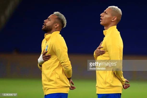 Neymar Jr. And Richarlison of Brazil sing the national anthem prior to the final of Copa America Brazil 2021 between Brazil and Argentina at Maracana...