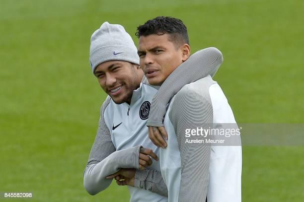 Neymar Jr and Thiago Silva of Paris SaintGermain react before a Paris SaintGermain training session at Centre Ooredoo on September 11 2017 in...