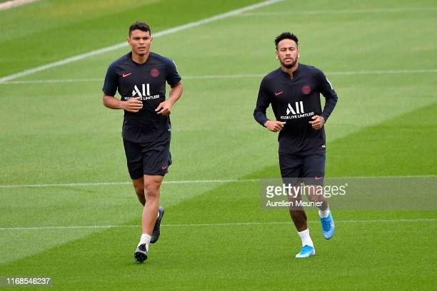 Neymar Jr and Thiago Silva warmup during a Paris SaintGermain training session at Centre Ooredoo on August 17 2019 in Paris France