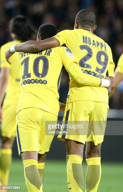Neymar Jr celebrates his goal with Kylian Mbappe during the French Ligue 1 match between FC Metz and Paris Saint Germain at Stade SaintSymphorien on...