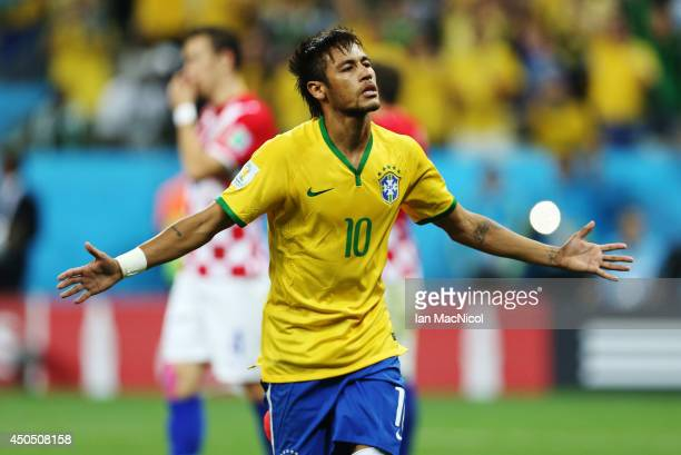 Neymar JR celebrates scoring a penalty during the opening match of the 2014 World Cup between Brazil and Croatia at Arena de Sao Paulo on June 12...