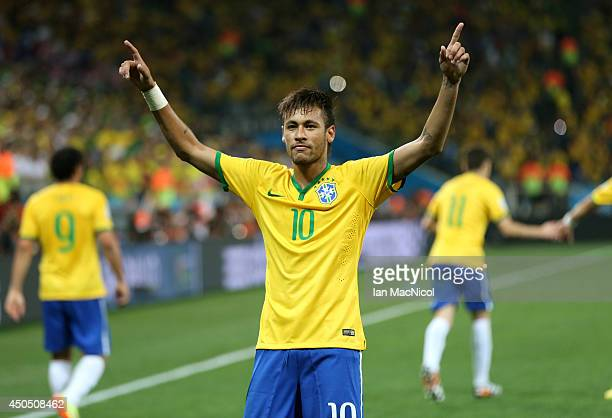 Neymar JR celebrates scoring a penaltyduring the opening match of the 2014 World Cup between Brazil and Croatia at Arena de Sao Paulo on June 12 2014...