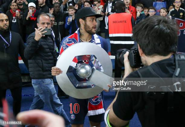Neymar Jr celebrates winning the 'French Championship 2019' during the trophy ceremony following the French Ligue 1 match between Paris Saint-Germain...
