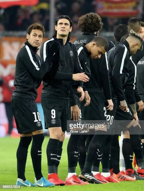 Neymar Jr Edinson Cavani Kylian Mbappe of Paris SaintGermain react during the UEFA Champions League group B match between Bayern Muenchen and Paris...