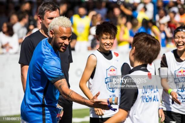 Neymar Jr greets members of Team Japan at Neymar Jr's Five World Final in Praia Grande Brazil on July 13 2019
