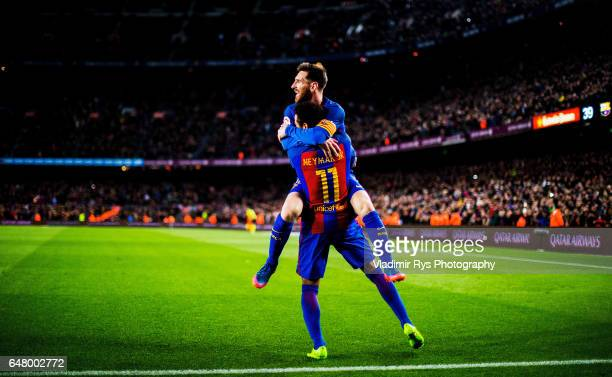 Neymar Jr is celebrated by his team mate Lionel Messi of Barcelona after scoring his team's second goal during the La Liga match between FC Barcelona...