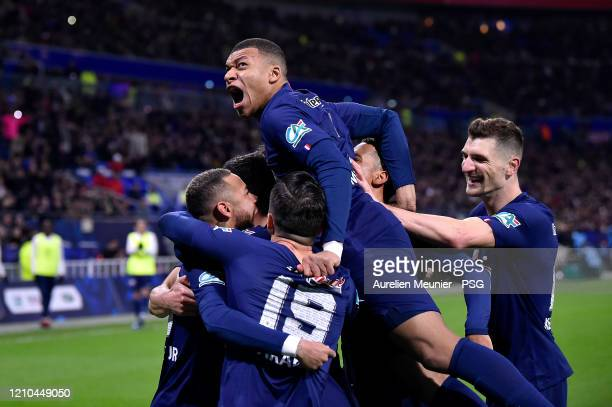 Neymar Jr is congratulated by teammate Kylian Mappe, Pablo Saraia and Thilo Kherer after scoring during the French Cup Semi Final match between...