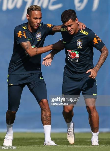 Neymar Jr jokes with Phillipe Coutinho during a Brazil training session at YugSport Stadium on June 24 2018 in Sochi Russia