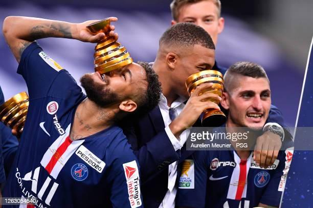 Neymar Jr, Kylian Mbappe and Marco Verratti Paris Saint-Germain raise the Trophy after winning the French League Cup final match against Olympique...