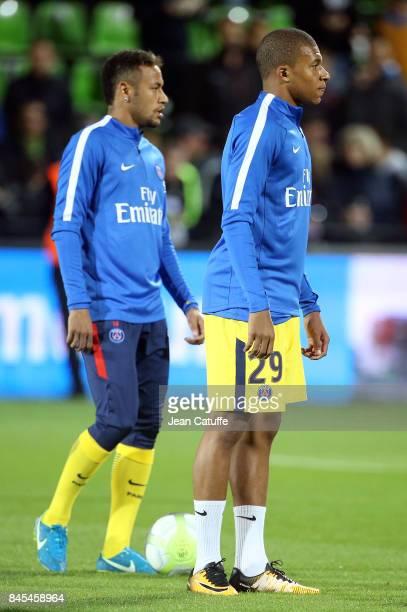 Neymar Jr Kylian Mbappe warm up before the French Ligue 1 match between FC Metz and Paris Saint Germain at Stade SaintSymphorien on September 9 2017...