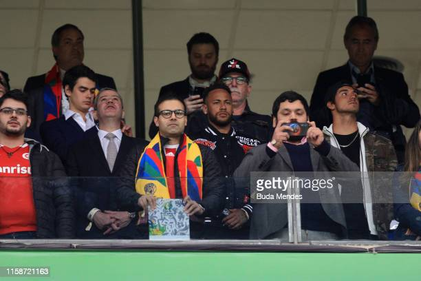 Neymar Jr looks on from the stands during the Copa America Brazil 2019 quarterfinal match between Brazil and Paraguay at Arena do Gremio on June 27...
