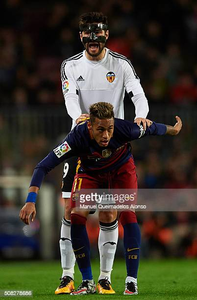 Neymar JR of Barcelona and Antonio Barragan of Valencia react during the Copa del Rey Semi Final first leg match between FC Barcelona and Valencia CF...