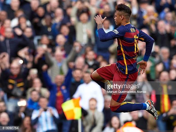 Neymar JR of Barcelona celebrates scoring his team's fifth goal during the La Liga match between FC Barcelona and Getafe CF at Camp Nou on March 12...
