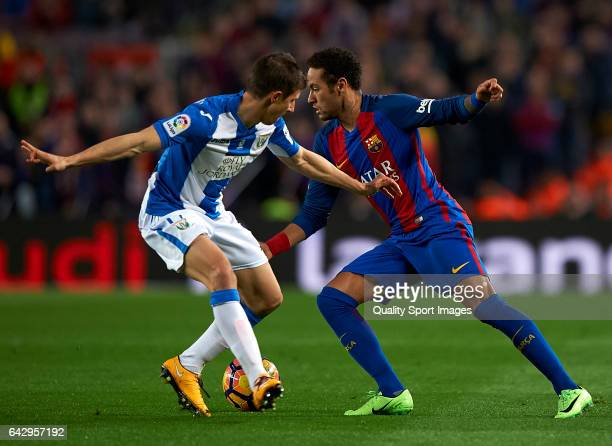Neymar Jr of Barcelona competes for the ball with Alexander Szymanowski of Leganes during the La Liga match between FC Barcelona and CD Leganes at...