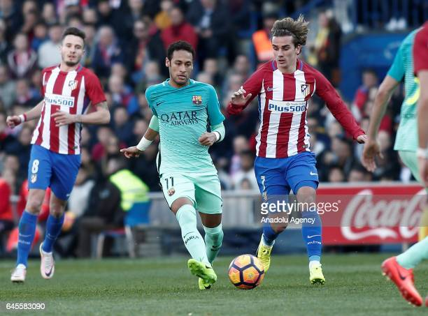 Neymar Jr of Barcelona in action against Antoine Griezmann of Atletico Madrid during the La Liga football match between Atletico Madrid and Barcelona...