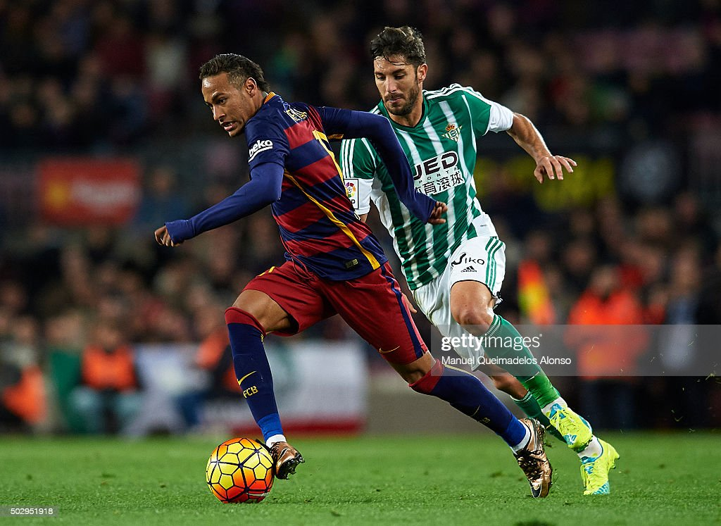 Neymar JR (L) of Barcelona is tackled by CeJudo of Betis during the La Liga match between FC Barcelona and Real Betis Balompie at Camp Nou on December 30, 2015 in Barcelona, Spain.