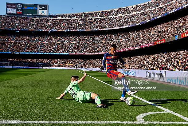 Neymar JR of Barcelona is tackled by Emiliano Buendia of Getafe during the La Liga match between FC Barcelona and Getafe CF at Camp Nou on March 12...