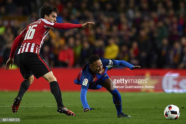 Neymar JR of Barcelona is tackled by Xabier Etxeita of Athletic Club during the Copa del Rey Round of 16 Second Leg match between FC Barcelona and...