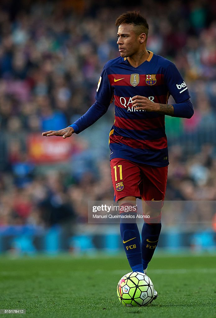 Neymar JR of Barcelona runs with the ball during the La Liga match between FC Barcelona and Getafe CF at Camp Nou on March 12, 2016 in Barcelona, Spain.