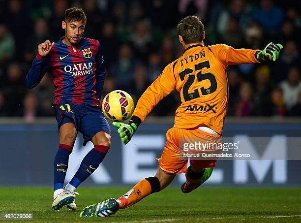 Neymar JR of Barcelona shoots to score the third goal during the La Liga match between Elche FC and FC Barcelona at Estadio Manuel Martinez Valero on...