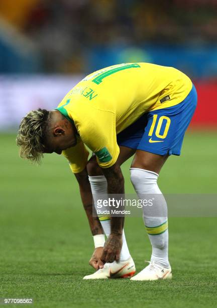 Neymar Jr of Brazil adjusts his boot during the 2018 FIFA World Cup Russia group E match between Brazil and Switzerland at Rostov Arena on June 17...