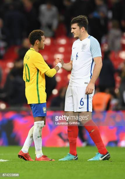 Neymar Jr of Brazil and Harry Maguire of England shake hands after the international friendly match between England and Brazil at Wembley Stadium on...