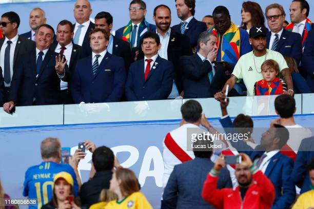 Neymar Jr. Of Brazil and his son Davi Lucca da Silva Santos looks on from the stands prior to the Copa America Brazil 2019 Final match between Brazil...
