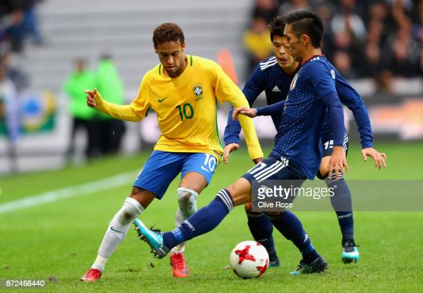 Neymar Jr of Brazil and Makoto Hasebe of Japan battle for possession during the international friendly match between Brazil and Japan at Stade...