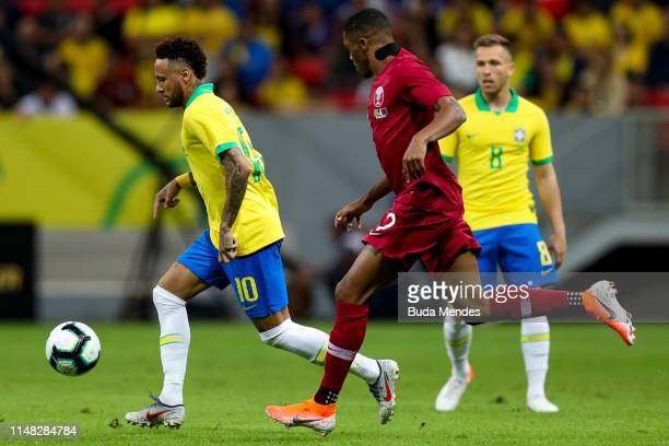 Neymar Jr of Brazil and Pedro Miguel Correia of Qatar compete for the ball during the International Friendly Match between Brazil and Qatar at Mane...