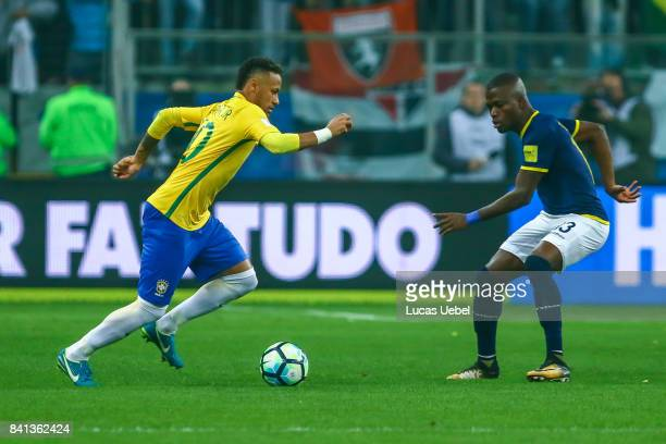 Neymar Jr of Brazil battles for the ball against Enner Valencia of Equador during the match Brazil v Equador 2018 FIFA World Cup Russia Qualifier at...