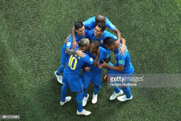 Neymar Jr of Brazil celebrates after scoring his team's second goal with teammates Douglas Costa Casemiro Miranda and Roberto Firmino during the 2018...