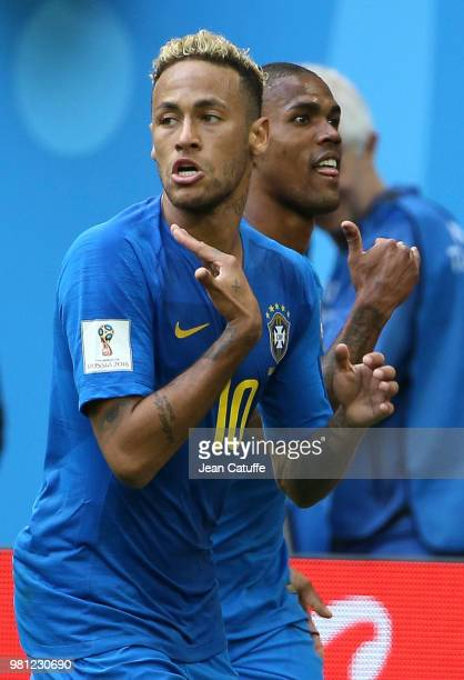Neymar Jr of Brazil celebrates scoring the second goal of his team with Douglas Costa during the 2018 FIFA World Cup Russia group E match between...