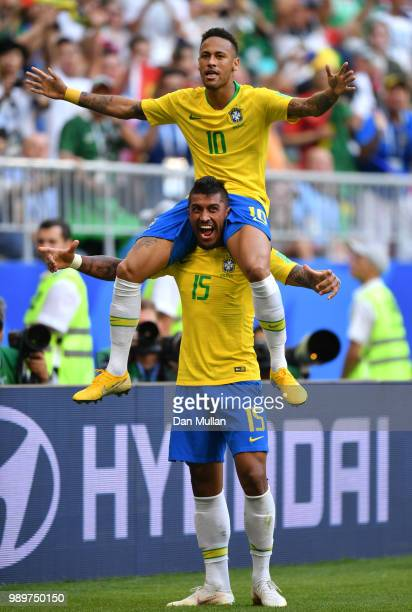 Neymar Jr of Brazil celebrates with teammate Paulinho after scoring his team's first goal during the 2018 FIFA World Cup Russia Round of 16 match...
