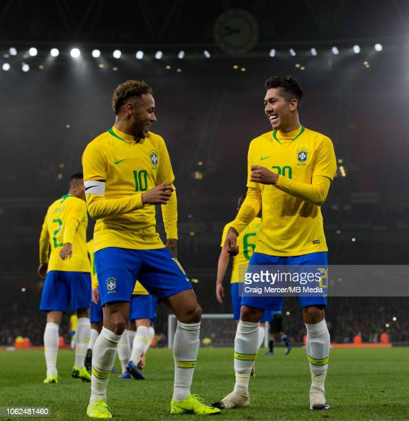 Neymar Jr of Brazil celebrates with teammate Roberto Firmino after scoring the opening goal during the International Friendly match between Brazil...