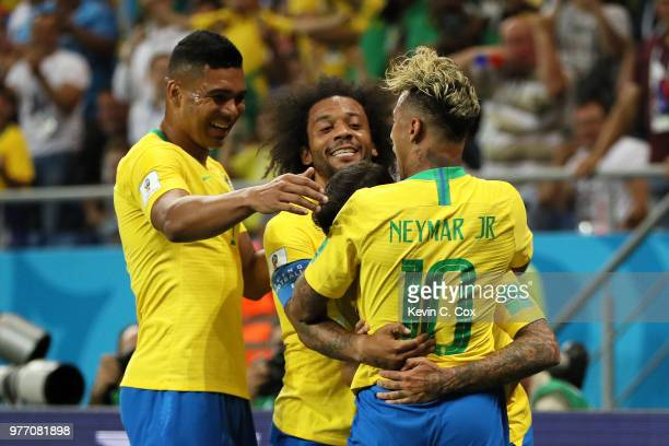 Neymar Jr of Brazil celebrates with teammates after scoring his team's first goal during the 2018 FIFA World Cup Russia group E match between Brazil...